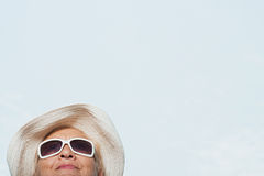 Woman wearing a sunhat and sunglasses Stock Photography