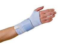 Woman Wearing Supportive Hand and Wrist Brace. Close Up of female Person with Hand and Wrist Wrapped in Supportive Brace and Secured with Velcro Strap in Studio Stock Photo