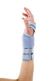 Woman Wearing Supportive Wrist Brace in Studio. Close Up of Woman Wearing Supportive Orthopedic Wrist Brace in Studio with White Background and Copy Space Stock Image