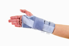 Woman Wearing Supportive Wrist Brace in Studio. Close Up of Woman Wearing Supportive Orthopedic Wrist Brace in Studio with White Background and Copy Space Royalty Free Stock Photo