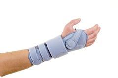 Woman Wearing Supportive Wrist Brace in Studio Stock Photos