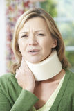 Woman Wearing Surgical Collar In Pain Stock Photography