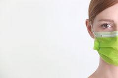 Woman wearing surgical mask Stock Image