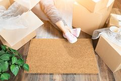 Woman Wearing Sweats Relaxing Near Home Sweet Home Welcome Mat, Stock Photo