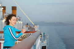 Woman wearing swimming suit is standing on deck Stock Photography