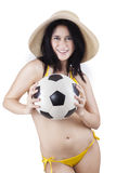 Woman wearing swimsuit and holding ball 1. Portrait of sexy woman wearing bikini holding a soccer ball. isolated on white Stock Image