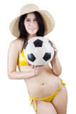 Woman wearing swimsuit and holding ball. Portrait of sexy woman wearing bikini holding a soccer ball. isolated on white Royalty Free Stock Photography