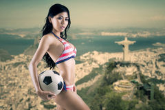 Woman wearing swimsuit with soccer ball 1 Royalty Free Stock Photos