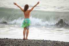 Woman wearing swimsuit is staying near water Royalty Free Stock Photo