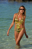 Woman wearing swimsuit and sunglasses royalty free stock photography
