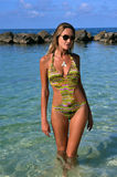 Woman wearing swimsuit and sunglasses royalty free stock images