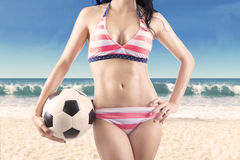 Woman wearing swimwear holding ball Royalty Free Stock Photography