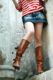 Woman wearing tall boots. Woman standing wearing tall leather boots Royalty Free Stock Photo