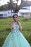 Woman Wearing Teal and White Floral Sleeveless Dress Royalty Free Stock Photo