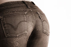 Woman wearing tight jeans Stock Image