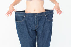 Woman wearing too large pants Stock Photography