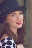 Woman wearing top hat Stock Photos