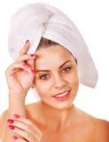Woman wearing towel on head. Stock Image
