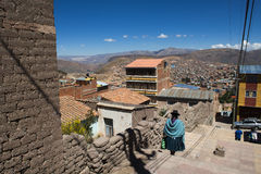 Woman wearing traditional clothes in the city of Potosi in Bolivia. Stock Photos