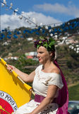 Woman wearing in traditional costume at Madeira Wine Festival in Estreito de Camara de Lobos, Madeira, Portugal. Stock Photo