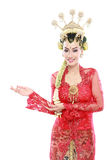 Woman wearing traditional of java presenting blank area Royalty Free Stock Images