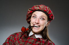 The woman wearing traditional scottish clothing Stock Images