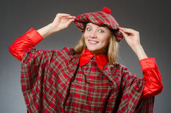 The woman wearing traditional scottish clothing Stock Photography