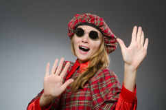The woman wearing traditional scottish clothing Stock Photo