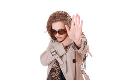 Woman wearing trenchcoat. Woman with glasses wearing trenchcoat standing on white Stock Images