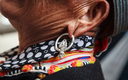 Woman wearing a tribal earring Stock Photography