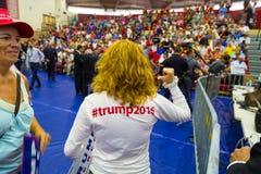 Woman wearing Trump Hashtag Shirt Stock Photography