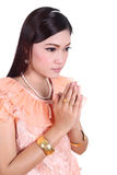 Woman wearing typical thai dress pay respect Royalty Free Stock Photography