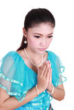 Woman wearing typical thai dress pay respect Stock Photo