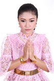 Woman wearing typical thai dress pay respect Stock Photography