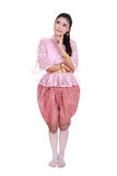Woman wearing typical thai dress thinking isolated on white back Stock Image