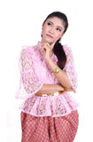 Woman wearing typical thai dress thinking Stock Photo