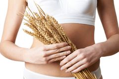 Close Up Of Woman Wearing Underwear Holding Bundle Of Wheat. Woman Wearing Underwear Holding Bundle Of Wheat Stock Photos