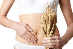 Close Up Of Woman Wearing Underwear Holding Bundle Of Wheat And. Woman Wearing Underwear Holding Bundle Of Wheat And Touching Stomach Stock Photos