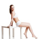 Woman wearing underwear over white Royalty Free Stock Photography