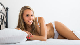 Woman wearing underwear posing on bed Stock Photography