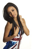 Woman wearing union jack sequin dress. Beautiful young woman wearing union jack sequin dress.  Image isolated against white background Royalty Free Stock Images