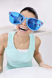 Woman wearing unique glasses Stock Photos