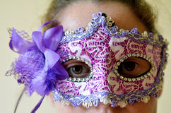 Woman wearing vintage venetian mask Royalty Free Stock Image