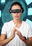 Woman wearing virtual reality glasses doing hands gestures against digital background Stock Image