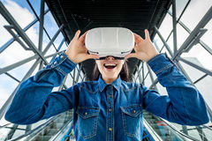 Woman wearing virtual reality glasses royalty free stock image