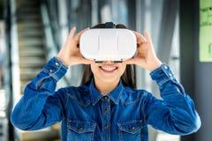 Woman wearing virtual reality glasses royalty free stock photo