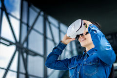 Woman wearing virtual reality glasses royalty free stock images