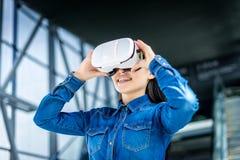Woman wearing virtual reality glasses stock photos