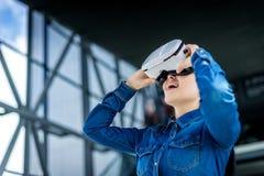 Woman wearing virtual reality glasses royalty free stock photography