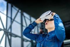 Woman wearing virtual reality glasses stock photo